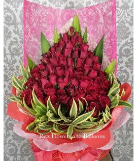 Five Dozen Red Roses Cascading Bouquet
